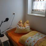 Wohnung 1: Schlafzimmer 1
